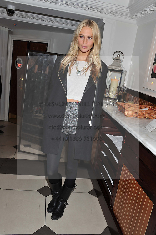 POPPY DELEVINGNE at a party hosted by TopShop to celebrate 10 years of NEWGEN and 10 years of supporting Brtish Fashion held at Le Baron, 29 Old Burlington Street, London W1 on 21st February 2012.