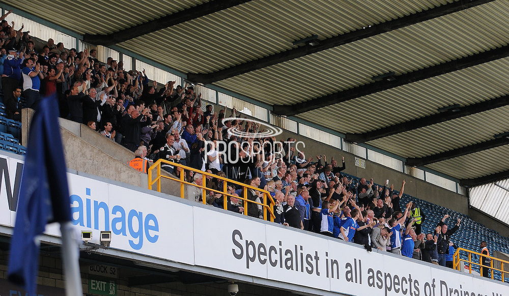 Rochdale fans celebrate their equaliser during the Sky Bet League 1 match between Millwall and Rochdale at The Den, London, England on 26 September 2015. Photo by Michael Hulf.