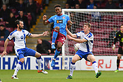 Scunthorpe United forward Ivan Toney (24) and Chesterfield FC defender Tom Anderson (23)   during the EFL Sky Bet League 1 match between Scunthorpe United and Chesterfield at Glanford Park, Scunthorpe, England on 17 April 2017. Photo by Ian Lyall.