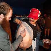 Jack Passion, the host of the evening and a former champion, signs a fan in Bend, Oregon on Saturday, June 5, 2010 following the Beard Team USA National Beard and Mustache Championships.
