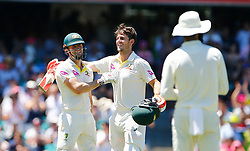 Australia's Mitchell Marsh Marsh celebrates his century with his brother Shaun during day four of the Ashes Test match at Sydney Cricket Ground.
