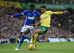 Ipswich Town's Dominic Iorfa (left) and Norwich City's Jamal Lewis battle for the ball during the Sky Bet Championship match at Carrow Road, Norwich.