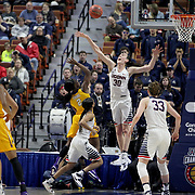 Breanna Stewart, UConn, defends the basket as Khadidja Toure, East Carolina, shoots during the UConn Huskies Vs East Carolina Pirates Quarter Final match at the  2016 American Athletic Conference Championships. Mohegan Sun Arena, Uncasville, Connecticut, USA. 5th March 2016. Photo Tim Clayton
