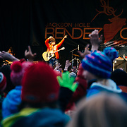 Micahel Franti and Spearhead perform to a packed crowd in Teton Village, Wyoming. Michael Franti engages crowd to follow his lead and put their arms in the air.
