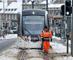 Pictured: Workers had to resort to using leaf blowers to keep the tram tracks clear in Edinburgh on Thursday morning.<br /> <br /> The severe winter weather continued to cause chaos throughout Scotland, with the most severe level of Amber warning being extended until 10am on Friday 02 March.<br /> <br /> &copy; Dave Johnston / EEm