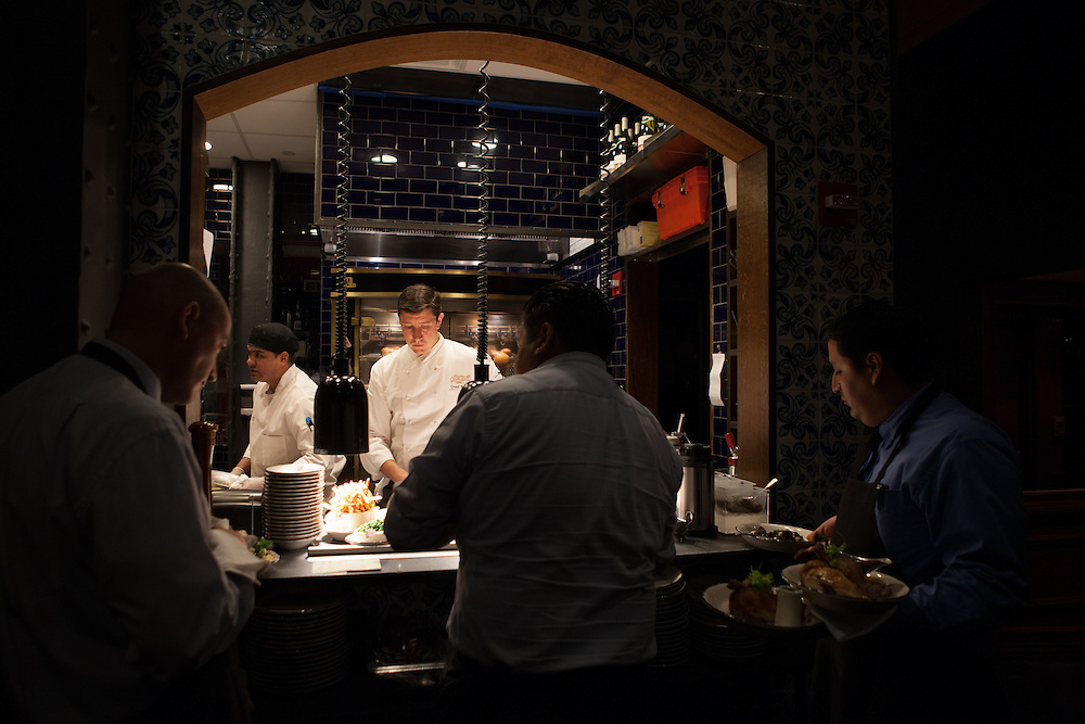 Executive Chef Chad Brauze, center, working in the open kitchen at Rotisserie Georgette in New York, NY on July 08, 2014. The restaurant has an open kitchen framed in beautiful blue-an-white Portuguese tile.