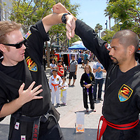 Senseis from Z-Ultimate Self Defense James Perchlak (left) and Paul Buenrostro teach a martial arts class during the Santa Monica Chamber of Commerce's 26th Annual Health and Fitness Festival at the Third Street Promenade on Saturday, July 30, 2011.