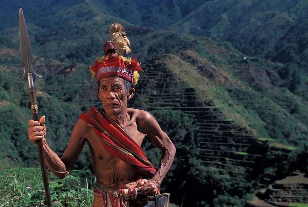 Philippines, Luzon Island, (MR) Ramia Bimunga in traditional Ifugao loin cloth posing for snapshots at Banaue terraces