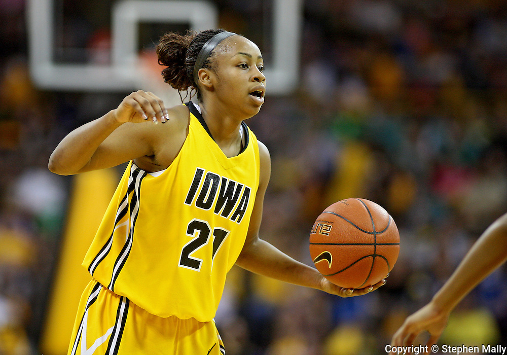 January 08 2010: Iowa guard Kachine Alexander (21) with the ball during the first half of an NCAA womens college basketball game at Carver-Hawkeye Arena in Iowa City, Iowa on January 08, 2010. Iowa defeated Ohio State 89-76.