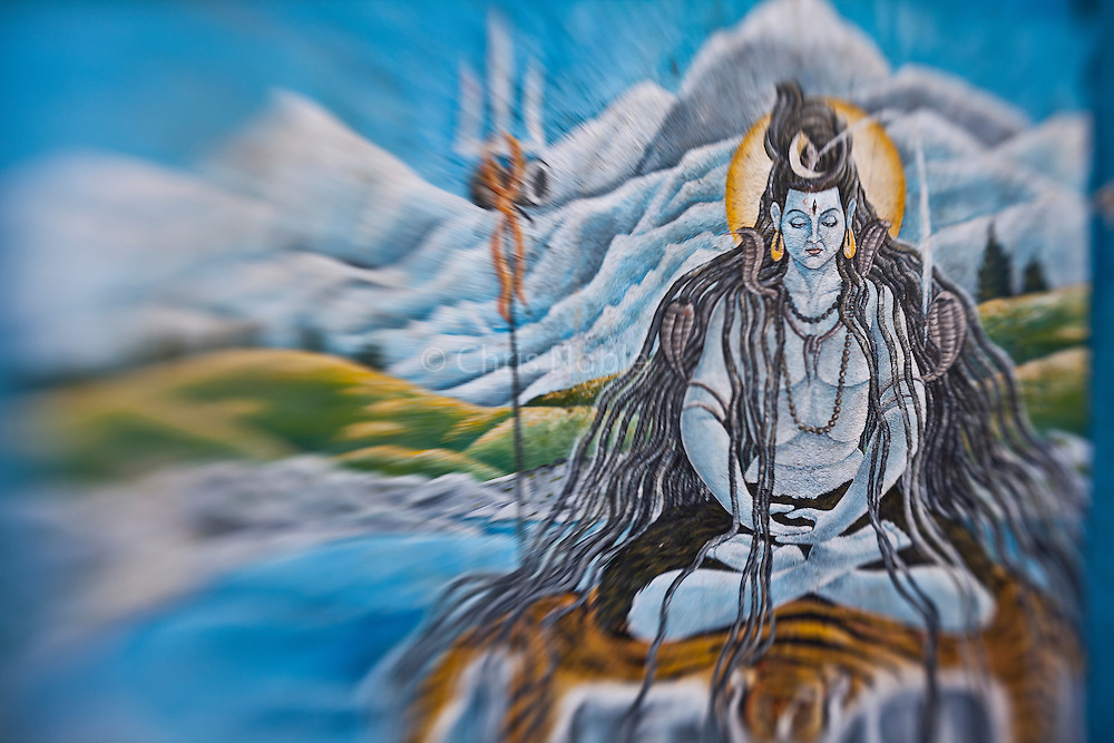 A painting of the Hindu god Shiva meditating in the Himalayas adorns the walls of a temple at Kathmandu's Pashupatinath.