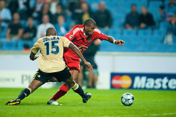 MARSEILLE, FRANCE - Tuesday, September 16, 2008: Liverpool's Ryan Babel is brought down by Olympique de Marseille's Ronald Zubar for a penalty during the opening UEFA Champions League Group D match at the Stade Velodrome. (Photo by David Rawcliffe/Propaganda)