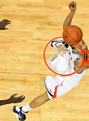 Virginia guard Calvin Baker (4) shoots a layup against VT.  The Virginia Cavaliers defeated the Virginia Tech Hokies 75-61 at the John Paul Jones Arena on the Grounds of the University of Virginia in Charlottesville, VA on February 18, 2009.