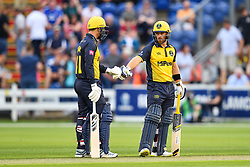 David Lloyd and Colin Ingram of Glamorgan chat at the end of the over<br /> <br /> Photographer Craig Thomas/Replay Images<br /> <br /> Vitality Blast T20 - Round 4 - Glamorgan v Middlesex - Friday 26th July 2019 - Sophia Gardens - Cardiff<br /> <br /> World Copyright © Replay Images . All rights reserved. info@replayimages.co.uk - http://replayimages.co.uk