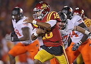 November 18, 2011: Iowa State Cyclones quarterback Jared Barnett (16) scrambles with the ball during the first half of the NCAA football game between the Oklahoma State Cowboys and the Iowa State Cyclones at Jack Trice Stadium in Ames, Iowa on Friday, November 18, 2011. At halftime Oklahoma State was leading Iowa State 17-7.