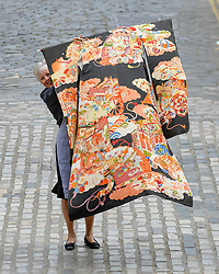 Pictured: Pictured: Bonham's Laura MacGregor with a 19th century furisode komono and matching obi (belt) before the sale. It is expected to fetch £500 - £700 GBP.<br /> <br /> Rare Asian art was on show for a photocall before it goes up for sale at Bonham's in Edinburgh.<br /> <br /> © Dave Johnston / EEm
