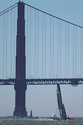 Oracle Team USA skippered by James Spithill sails past the Golden Gate Bridge in the San Francisco Bay during the 2013 America's Cup Finals San Francisco, California.