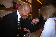 Michael Roberts and Lady Amanda Harlech. Christopher Bailey hosts a party to celebrate the launch of ' The Snippy World of New Yorker Fashion Artist Michael Roberts' Burberry, New Bond St.  London. 19  September 2005. ONE TIME USE ONLY - DO NOT ARCHIVE © Copyright Photograph by Dafydd Jones 66 Stockwell Park Rd. London SW9 0DA Tel 020 7733 0108 www.dafjones.com