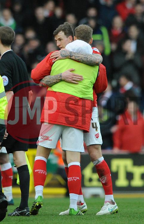 Bristol City's Matt Smith hugs Bristol City's Aden Flint after the game - Photo mandatory by-line: Dougie Allward/JMP - Mobile: 07966 386802 - 28/02/2015 - SPORT - football - Bristol - Ashton Gate - Bristol City v Rochdale AFC - Sky Bet League One