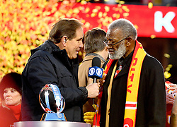 Jan 19, 2020; Kansas City, Missouri, USA; CBS sportscaster Jim Nantz speaks with  former Kansas City Chiefs player Bobby Bell after the AFC Championship Game against the Tennessee Titans at Arrowhead Stadium. Mandatory Credit: Denny Medley-USA TODAY Sports