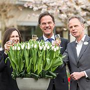 NLD/Lisse/20190417 - Minister Rutte doopt tulp inde Keukenhof, Minister-president Mark Rutte toast samen met Gallit Dobner (Canadese ambassade) en  Bart Siemerink  op de doop van de tulp