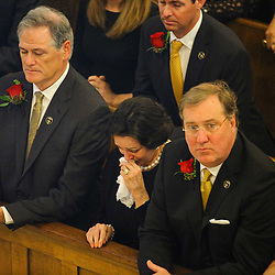 Gayle Benson (center) with New Orleans Saints general manager Mickey Loomis (left) and team president Dennis Laucsha (right) at the funeral service for NFL New Orleans Saints owner and NBA New Orleans Pelicans owner Tom Benson in New Orleans, Friday, March 23, 2018. Benson died last Thursday at the age of 90. (AP Photo/Derick Hingle)
