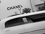 A white stretched limousine passes the Chanel store in Tumon, Guam, on Saturday, Mar. 10, 2007.  Sometimes known as 'America in Asia', Guam is a popular destination for Japanese tourists ( accounting for approx 90% of the island's visitors) with average visitor numbers from Japan approaching 1million.  The island, a 3.5 hour flight from Japan, has more than 20 large hotels and numerous duty-free shopping malls catering to the Japanese tourists predilection for designer brand name goods, as well as golfing and other water based entertainment features. In 2007-2008 US military personal currently stationed in the Japanese Okinawan Islands will relocate their bases and operations  to Guam, helping to stabilise the island's economy which suffered after tourism decreased in recent years due to a  fear of flying by Japanese post 9-11 World Trade Centre disaster, a 2003 typhoon and the SARS disease outbreak in Asia.