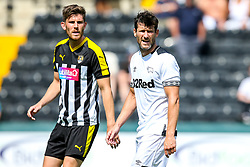 David Nugent of Derby County is marked by Shaun Brisley of Notts County - Mandatory by-line: Robbie Stephenson/JMP - 14/07/2018 - FOOTBALL - Meadow Lane - Nottingham, England - Notts County v Derby County - Pre-season friendly
