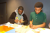 The 2018 Black Creativity program at the Museum of Science and Industry continued its month-long program Thursday afternoon, February 1st, 2018 with a class on developing new ideas and making those ideas a reality. Grammar school students from the House of Excellence school were encouraged to come up with ideas for necessary practical things and then develop and build models of those things.<br /> <br /> 4386 &ndash; House of Excellence School staff member, Kevin Wallace and student, Lennie Myles develop a new design for basketball courts.<br /> <br /> Please 'Like' &quot;Spencer Bibbs Photography&quot; on Facebook.<br /> <br /> Please leave a review for Spencer Bibbs Photography on Yelp.<br /> <br /> All rights to this photo are owned by Spencer Bibbs of Spencer Bibbs Photography and may only be used in any way shape or form, whole or in part with written permission by the owner of the photo, Spencer Bibbs.<br /> <br /> For all of your photography needs, please contact Spencer Bibbs at 773-895-4744. I can also be reached in the following ways:<br /> <br /> Website &ndash; www.spbdigitalconcepts.photoshelter.com<br /> <br /> Text - Text &ldquo;Spencer Bibbs&rdquo; to 72727<br /> <br /> Email &ndash; spencerbibbsphotography@yahoo.com