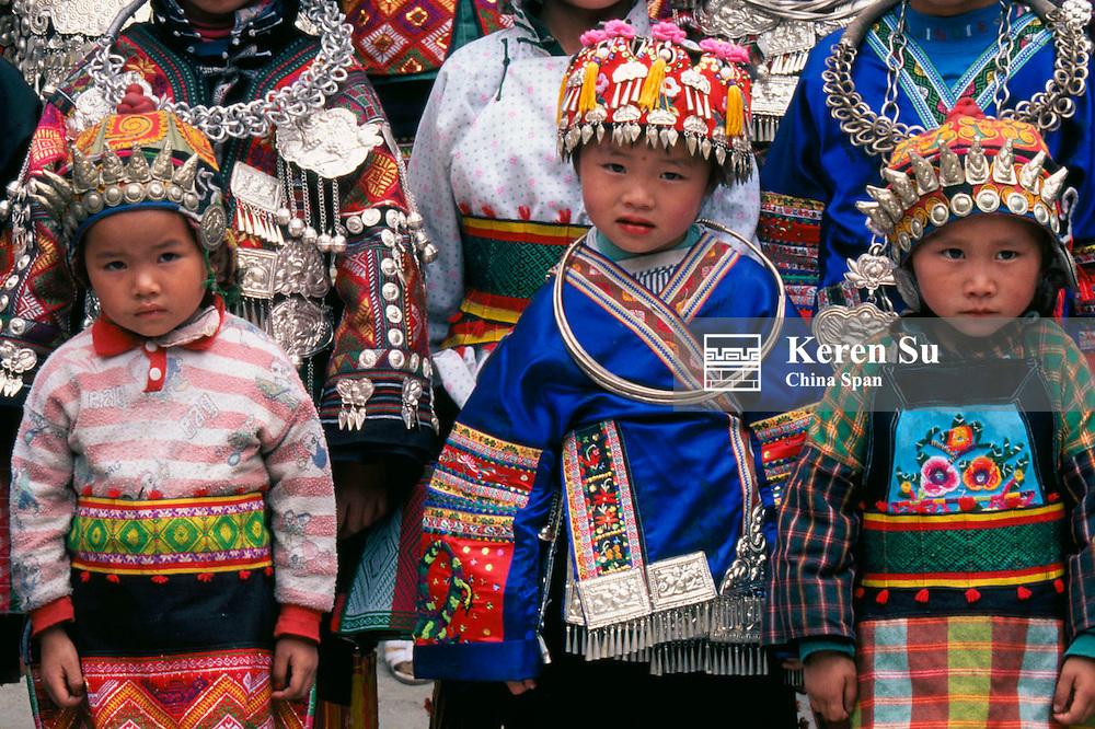 Miao children in traditional costume, Guizhou Province, China