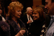 Edna O'Brien and Mrs. Ian McEwan. Book party for Saturday by Ian McEwan, Polish Club, South Kensington.  4 February 2005. ONE TIME USE ONLY - DO NOT ARCHIVE  © Copyright Photograph by Dafydd Jones 66 Stockwell Park Rd. London SW9 0DA Tel 020 7733 0108 www.dafjones.com