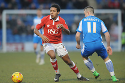 Bristol City's Korey Smith passes Colchester United's Jack Marriott - Photo mandatory by-line: Dougie Allward/JMP - Mobile: 07966 386802 - 21/02/2015 - SPORT - Football - Colchester - Colchester Community Stadium - Colchester United v Bristol City - Sky Bet League One