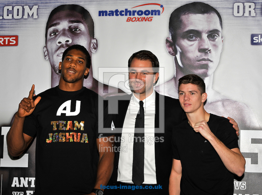 Picture by Alan Stanford/Focus Images Ltd +44 7915 056117<br />03/10/2013<br />Anthony Joshua MBE  Promoter Eddie Hearn and Luke Campbell MBE pictured during a Matchroom Sports press conference at International Hotel, Canary Wharf, London.