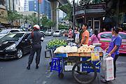 18 MARCH 2009 -- BANGKOK, THAILAND: Push cart vendors try to cross Sukhumvit at Soi 4 (Soi Nana) in Bangkok, Thailand.  Photo By Jack Kurtz