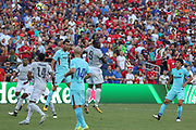 Barcelona Sergio Busquets and Manchester United Forward Romelu Lukaku jump for a header during the International Champions Cup match between Barcelona and Manchester United at FedEx Field, Landover, United States on 26 July 2017.