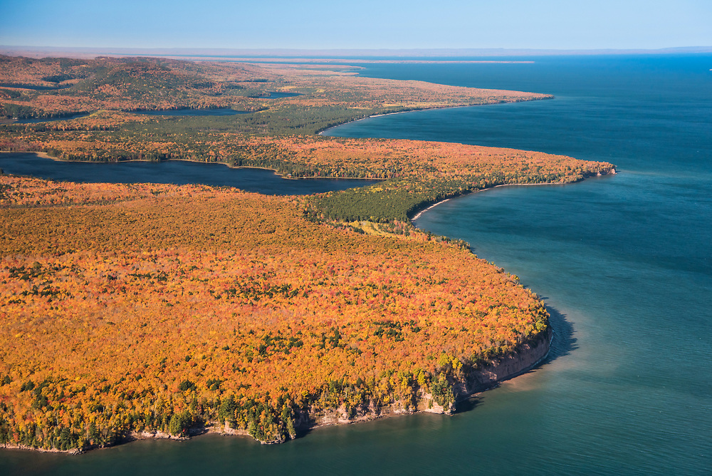 Aerial photography of the rugged Lake Superior shoreline near Big Bay, Michigan during fall color season. Areas shown include Conway Point.