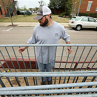 Adam Robison | BUY AT PHOTOS.DJOURNAL.COM<br /> Jake Logan, Tupelo Public Works employee, unloads barricade gates in front of City Hall at Fairpark Thursday morning in Tupelo for this weekends Color Vibe 5K and NOleput festival