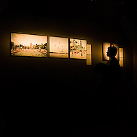 Silhouette of a young man looking at pictures