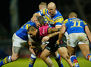 Brett Delaney (L) and Carl Ablett of Leeds Rhinos tackle Sika Manu of Hull FC during the Betfred Super League match at Emerald Headingley Stadium, Leeds<br /> Picture by Stephen Gaunt/Focus Images Ltd +447904 833202<br /> 08/03/2018