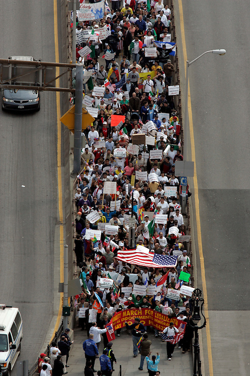 Demonstrators march across the Brooklyn Bridge in opposition of the US immigration Policy in New York, Saturday 1 April 2006.