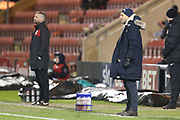 Crewe manager David Artell and Exeter's Paul Tisdale  during the EFL Sky Bet League 2 match between Crewe Alexandra and Exeter City at Alexandra Stadium, Crewe, England on 20 February 2018. Picture by Graham Holt.