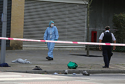 © Licensed to London News Pictures. 18/08/2020. London, UK. A forensic officer on Jubilee Avenue in Chingford, East London after a man was stab near Highams Park railway station. Police were called shortly before 02:30hrs on Tuesday, 18 August following reports of a man with stab injuries. Prior to the arrival of London Ambulance Service, officers carried out first aid on the 18-year-old- man. He was taken to an east London hospital and his injuries are currently believed to be life threatening. The man is thought to have sustained his injuries during a fight with three other men near to the railway crossing. Photo credit: Dinendra Haria/LNP