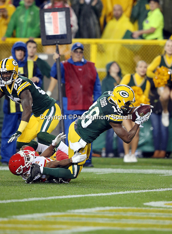 Green Bay Packers wide receiver Randall Cobb (18) catches a pass and stretches for a 4 yard touchdown and a 31-7 third quarter Packers lead during the 2015 NFL week 3 regular season football game against the Kansas City Chiefs on Monday, Sept. 28, 2015 in Green Bay, Wis. The Packers won the game 38-28. (©Paul Anthony Spinelli)