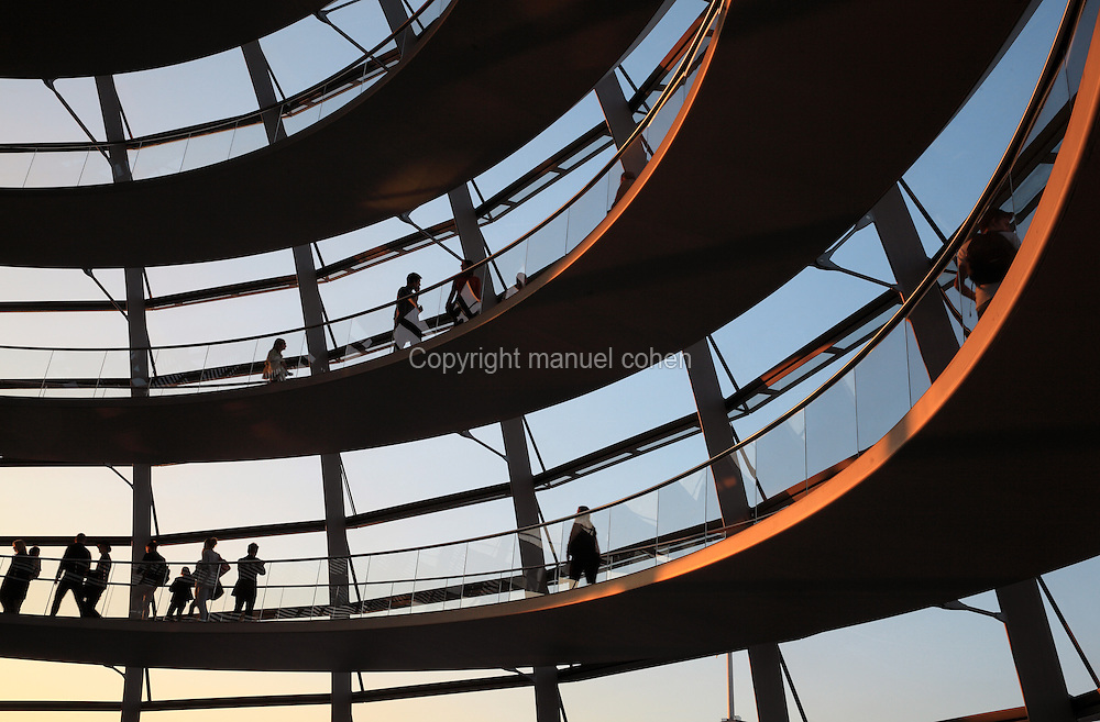 Spiralling access ramps in double-helix form to access the glass dome of the Reichstag building, seat of the German parliament and meeting place of the Bundestag, originally opened 1894 but refurbished by Norman Foster 1990-99, Berlin, Germany. The dome is open to the public and has panoramic views over the city. The debating chamber of the Bundestag can be viewed below the dome, symbolising that the people of the reunified Germany are above the government. Picture by Manuel Cohen
