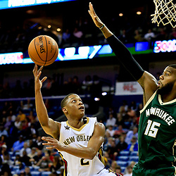 Nov 1, 2016; New Orleans, LA, USA; New Orleans Pelicans guard Tim Frazier (2) shoots over Milwaukee Bucks center Greg Monroe (15) during the third quarter of a game at the Smoothie King Center. Mandatory Credit: Derick E. Hingle-USA TODAY Sports