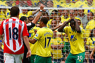 Leon Barnett of Norwich is sent off by Referee Neil Swarbrick and a penalty awarded against him during the Barclays Premier League match at Carrow Road Stadium, Norwich, Norfolk...Picture by Paul Chesterton/Focus Images Ltd.  07904 640267.21/8/11