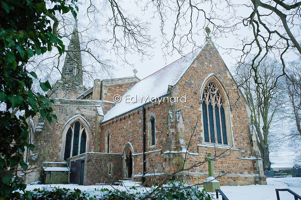 Snow covering St Deny's Church, Evington Village, Leicester, England, UK.
