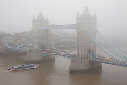 © Licensed to London News Pictures. 24/09/2013. London, UK. Tower Bridge is seen through heavy fog this morning (24/09/2013) in London. Photo credit: Matt Cetti-Roberts/LNP