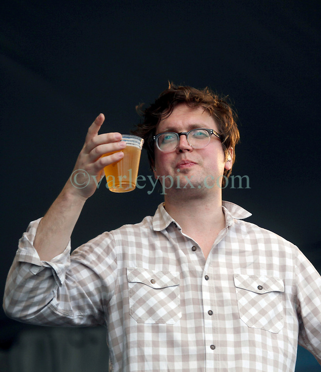 27 April 2012. New Orleans, Louisiana,  USA. .New Orleans Jazz and Heritage Festival. .British indie rock band Gomez plays the Gentilly stage. Tom Gray enjoys the gig..Photo; Charlie Varley.