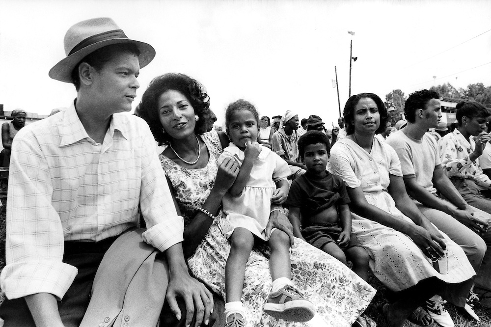 "Civil rights leader, politician, actor and former Chairman of the NAACP, Julian Bond, has died at age 75. Bond - left - sits with actress Pam Grier and extras during the filming of the 1977 feature film, ""Greased Lightning"". The film starred Grier, Richard Pryor and Beau Bridges and chronicled the life of the first African American NASCAR driver - Wendell Scott."