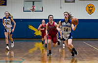 Belmont's Makenzie Donovan and Winnisquam's Shannon Goodwin take the court for first round play of the 44th annual Holiday Basketball Tournament played at Gilford Middle/High School on Wednesday afternoon.  (Karen Bobotas/for the Laconia Daily Sun)